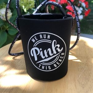Pink soda/beer can holder.